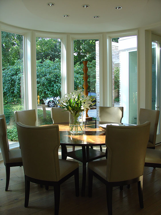 Dining room with contemporary dining chairs and an antique table