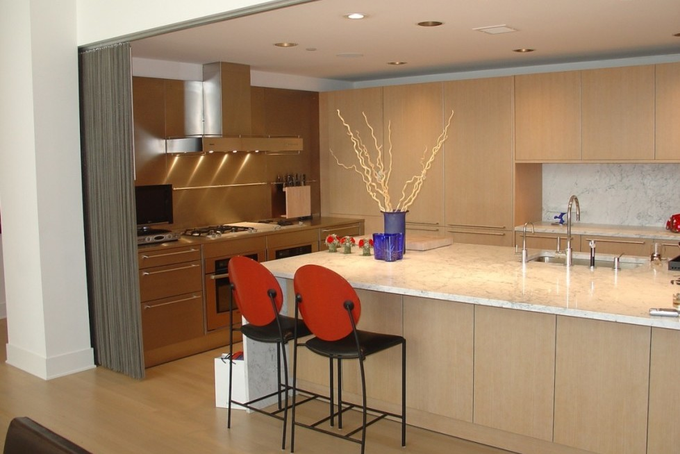 contemporary kitchen with white marble counters and oak cabinets - Kitchens Interior Design