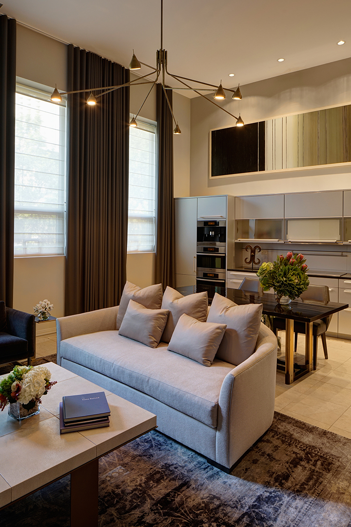 Chic Townhouse Living Room With Leather Coffee Table, Vintage Chairs And  Upholstered Sofa.
